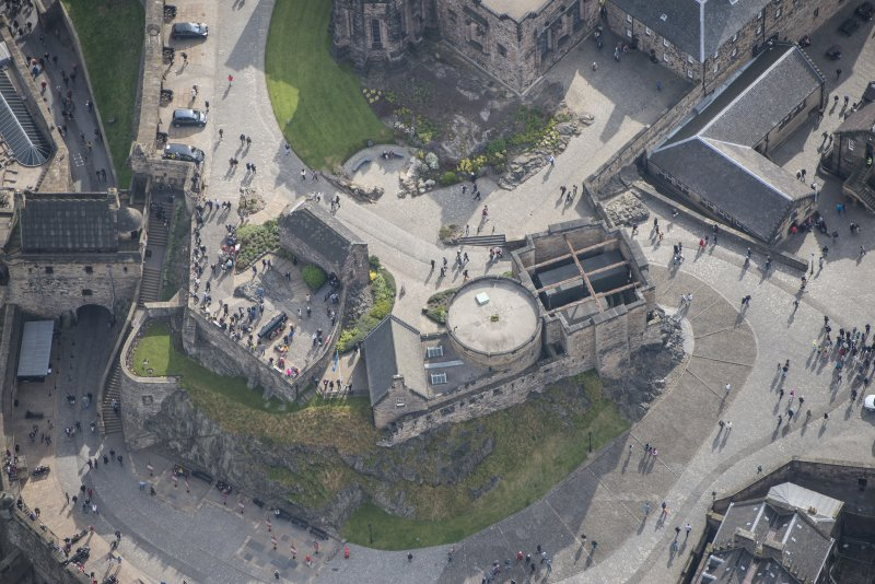 Oblique aerial view of Edinburgh Castle centred on St Margaret's Chapel,  looking E.