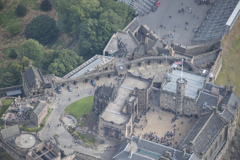 Oblique aerial view of Edinburgh Castle centred on the Scottish National War Memorial,  looking NE.