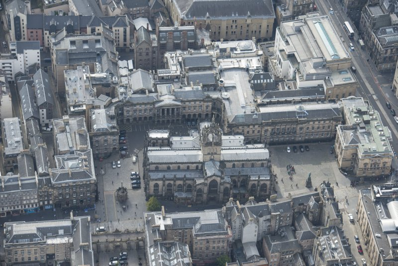 Oblique aerial view of the High Street, Parliament Square and St Giles Cathedral, looking WSW.