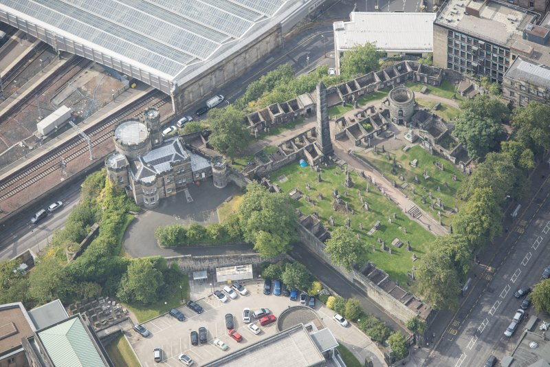 Oblique aerial view of Old Calton Burial Ground and Governor's House, looking SE.