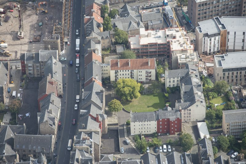 Oblique aerial view of Chessel's Court and Canongate, looking E.