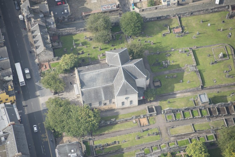 Oblique aerial view of Canogate Tolbooth and Canongate Parish Church, looking W.