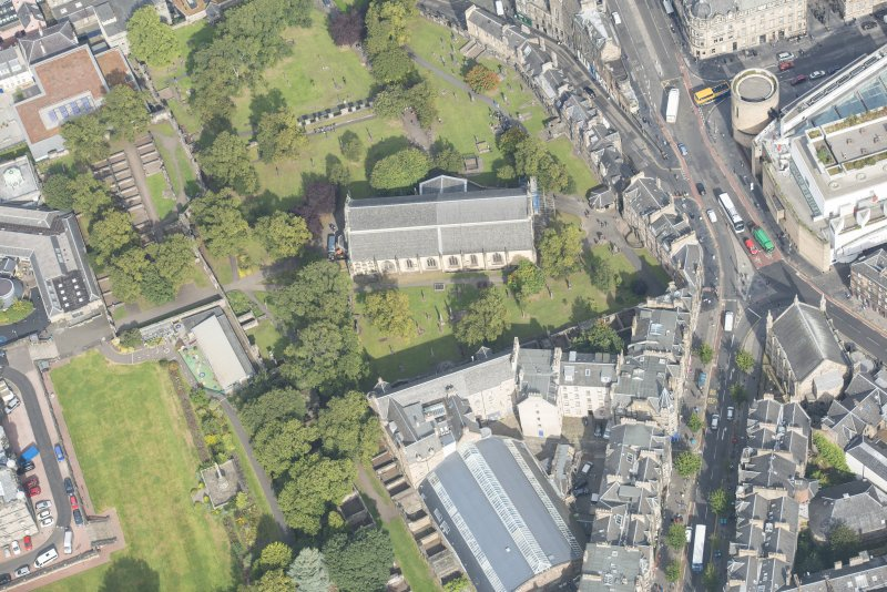 Oblique aerial view of Greyfriars Church and Churchyard, Greyfriars Place, Forrest Road and Candlemaker Row, looking N.