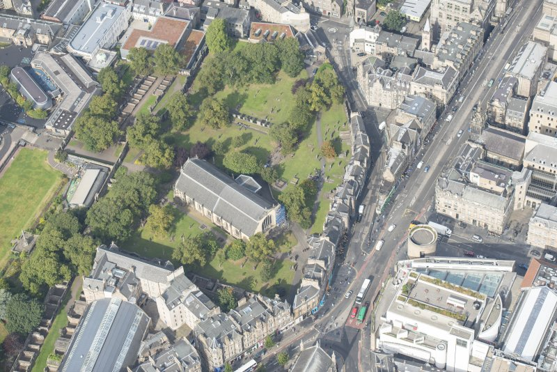 Oblique aerial view of Greyfriars Church and Churchyard, Greyfriars Place, Candlemaker Row and Magdalen Chapel, looking NW.