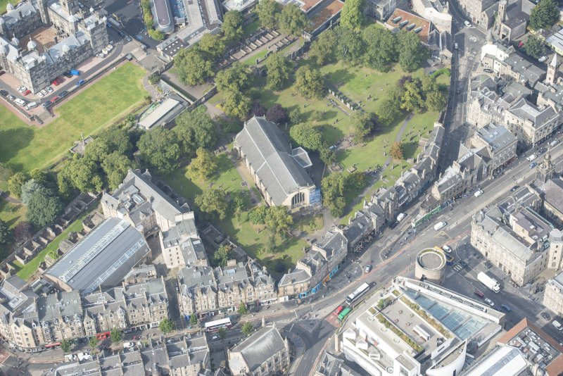 Oblique aerial view of Greyfriars Church and Churchyard, Greyfriars Place, Candlemaker Row and Magdalen Chapel, looking WNW.