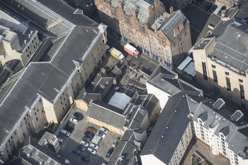 Oblique aerial view of Tailor's Hall, looking NW.