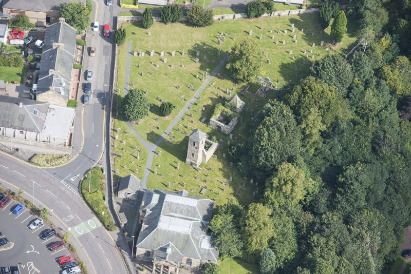 Oblique aerial view of St Kentigern's Church and Churchyard, looking NE.