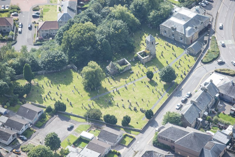 Oblique aerial view of St Kentigern's Church and Churchyard, looking SW.