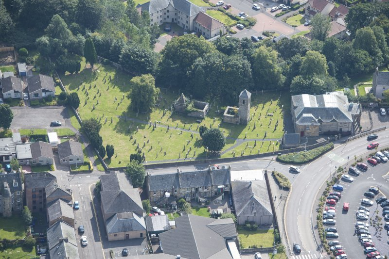 Oblique aerial view of St Kentigern's Church and Churchyard, looking SSE.