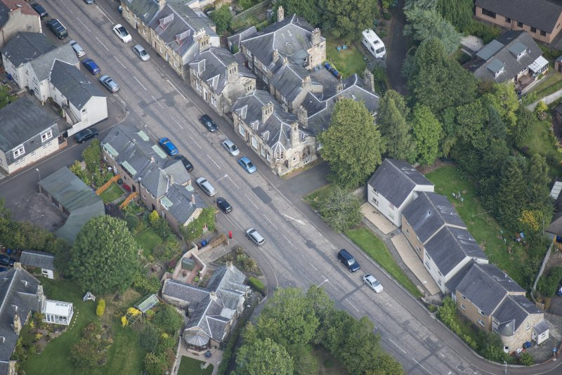 Oblique aerial view of Bridge Street and Parkend, looking NE.