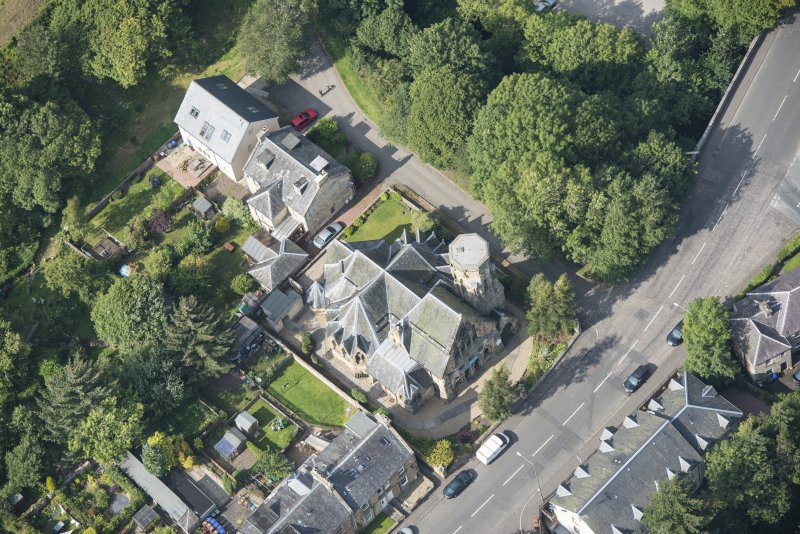 Oblique aerial view of Penicuik Free Church, looking SE.