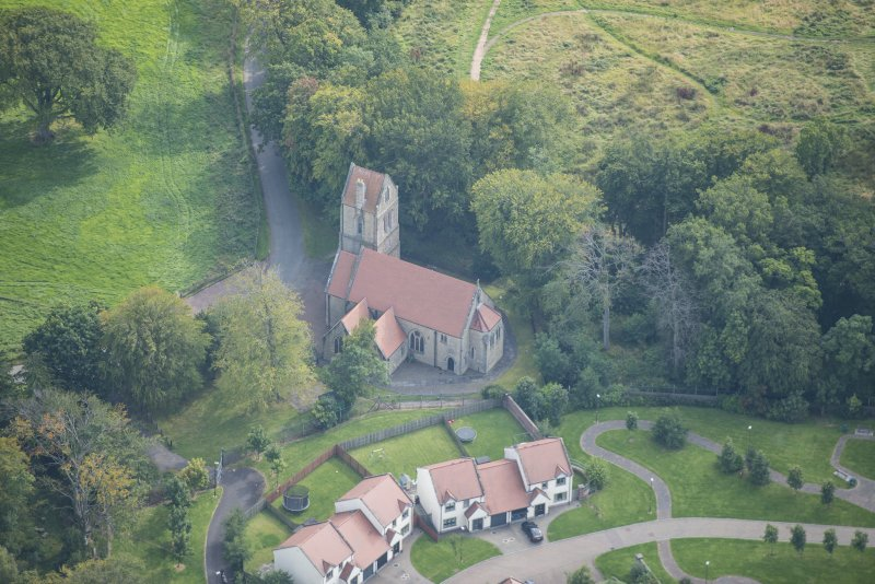 Oblique aerial view of Glencorse Parish Church, looking ESE.