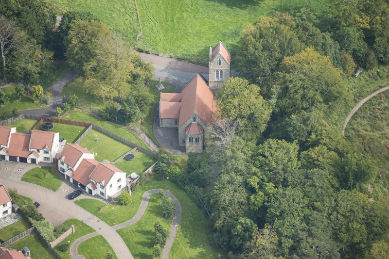 Oblique aerial view of Glencorse Parish Church, looking E.