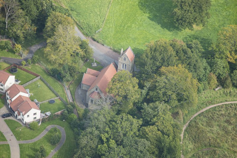 Oblique aerial view of Glencorse Parish Church, looking ENE.