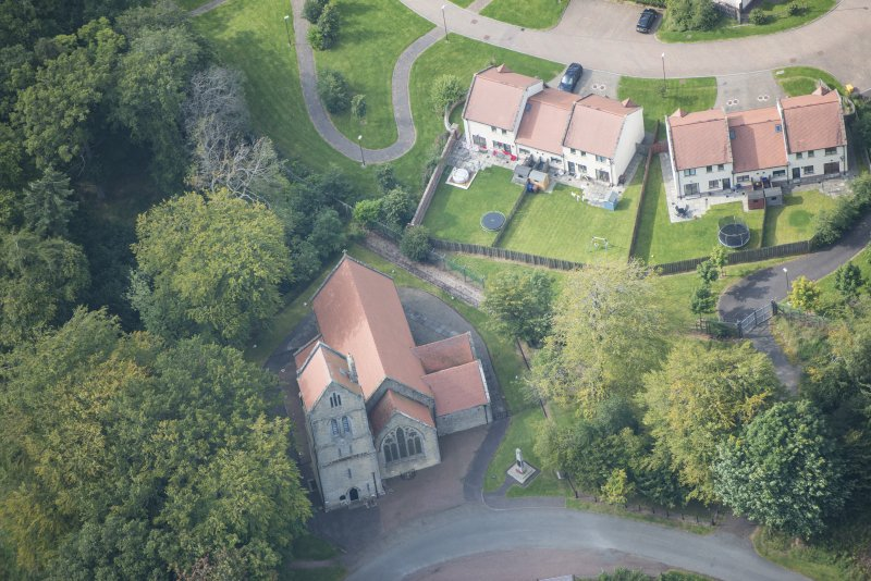 Oblique aerial view of Glencorse Parish Church, looking W.