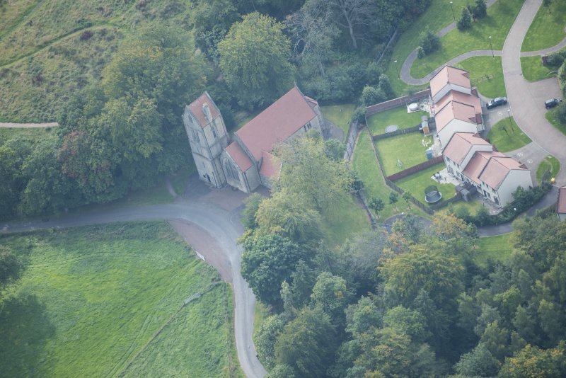 Oblique aerial view of Glencorse Parish Church, looking SW.