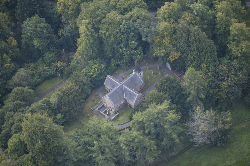 Oblique aerial view of Glencorse Old Parish Church, looking SW.