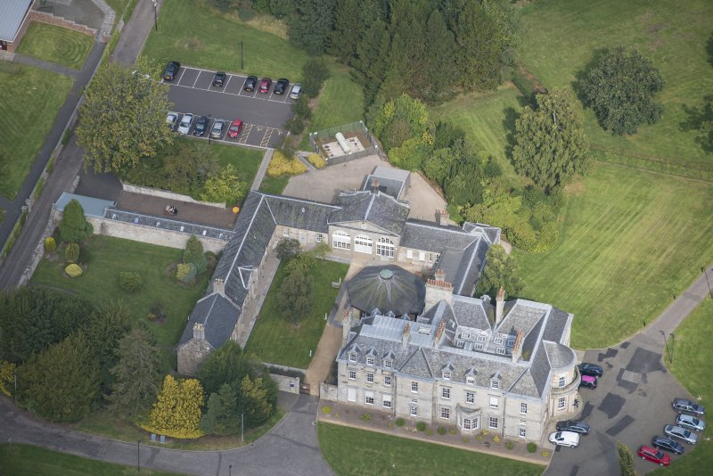 Oblique aerial view of The Bush House Estate, looking N.