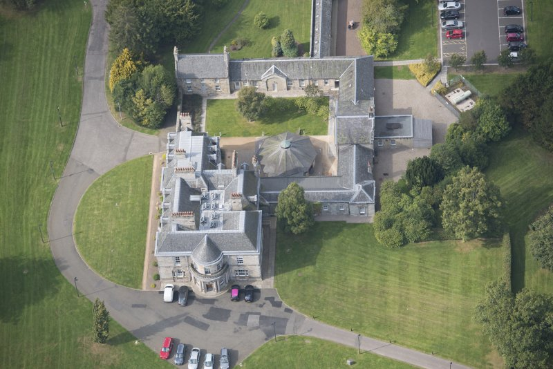Oblique aerial view of The Bush House Estate, looking NW.