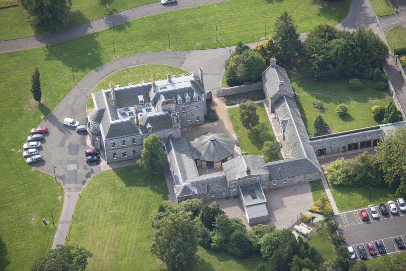Oblique aerial view of The Bush House Estate, looking SW.