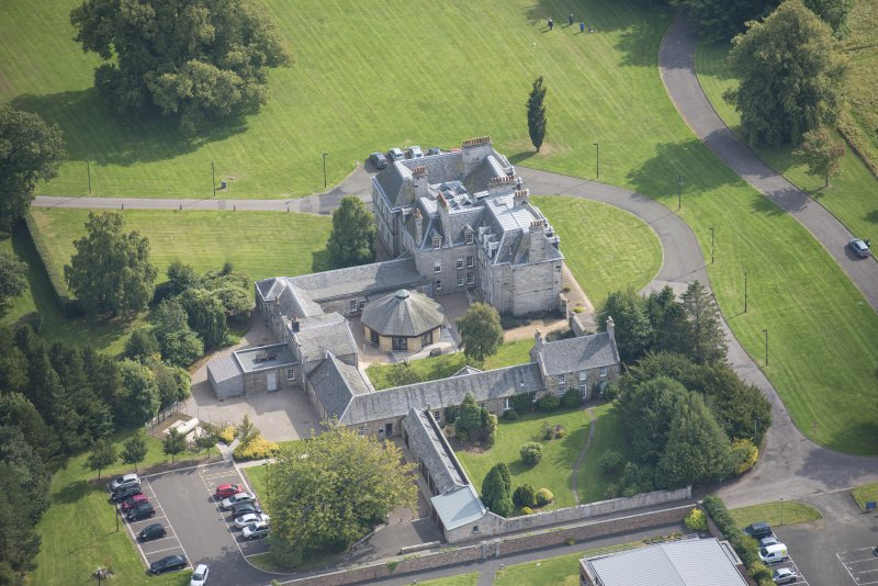 Oblique aerial view of The Bush House Estate, looking SSE.