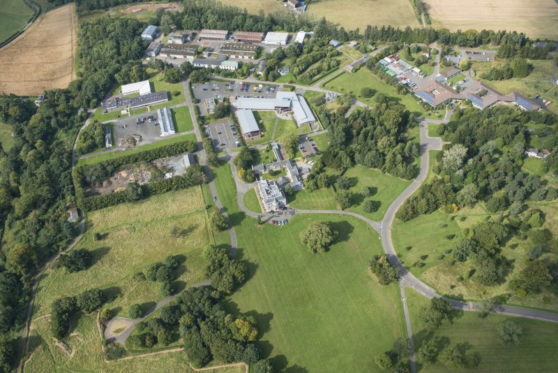 Oblique aerial view of The Bush House Estate, looking WNW.