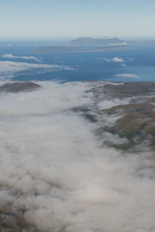 General oblique aerial view of Eigg and Rum, looking NW.