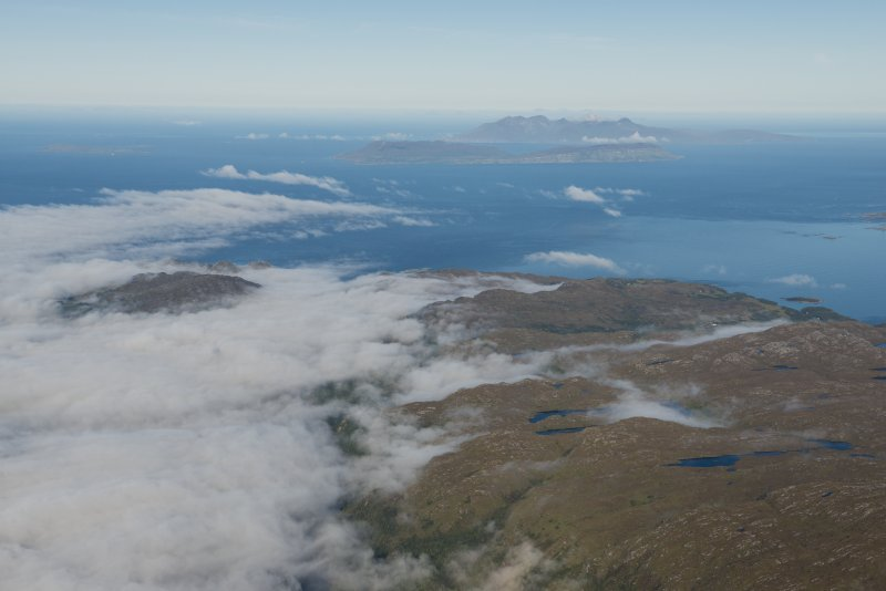 General oblique aerial view of Muck, Eigg and Rum, looking WNW.