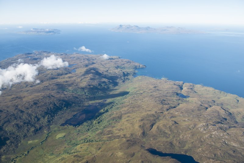 General oblique aerial view of Eigg, Rum and Canna with Gleann Meadhonach, Sleat, in the foreground, looking WSW.