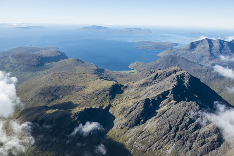 General oblique aerial view of Blabheinn with the Cullin Hills, Loch Scavaig, Soay, Eigg, Rum and Canna beyond, looking SSW.