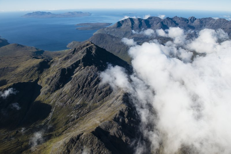 General oblique aerial view of Blabheinn with the Cullin Hills, Loch Scavaig, Soay, Rum and Canna beyond, looking SSW.