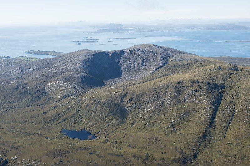 General oblique aerial view of Roineabhal with the Sound of Harris, Eabhal, Thacla and Beinn Mhor beyond, looking SSW.
