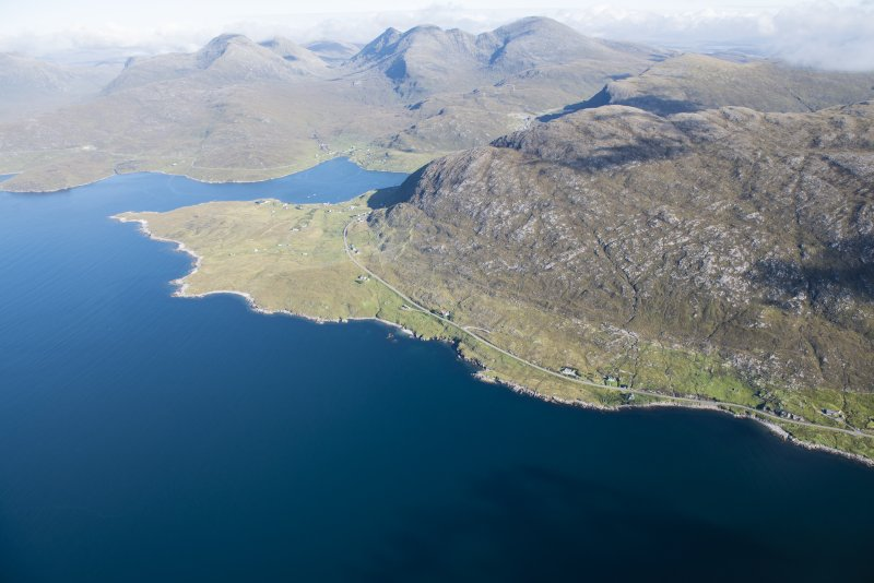 General oblique aerial view of Loch a Siar and Ardhasaig with An Clisean beyond, looking NNE.