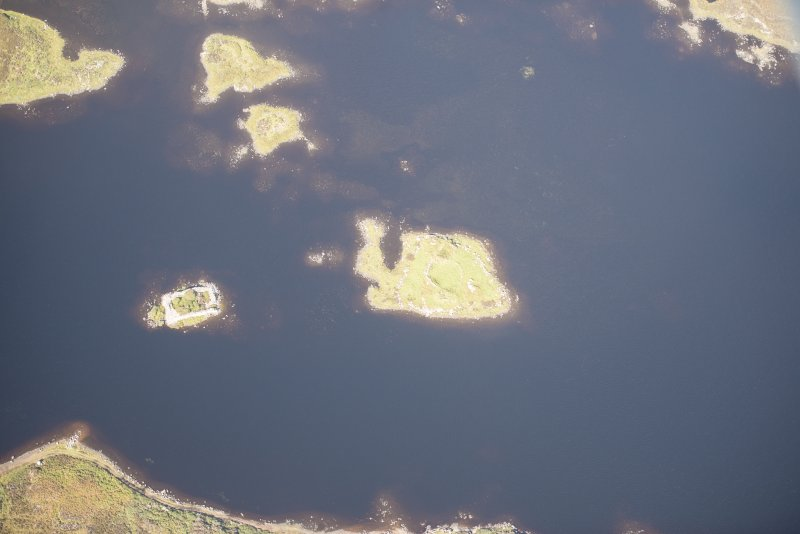 Oblique aerial view of Dun Raouill, looking NW.
