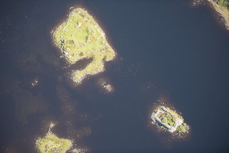 Oblique aerial view of Dun Raouill and the adjacent island, looking E.