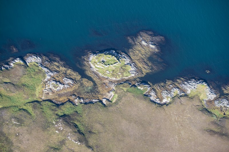 Oblique aerial view of Calvay Castle, looking N.