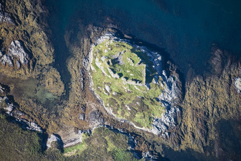Oblique aerial view of Calvay Castle, looking NW.