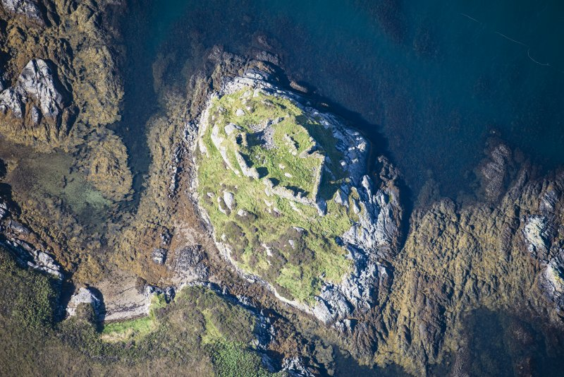 Oblique aerial view of Calvay Castle, looking WNW.