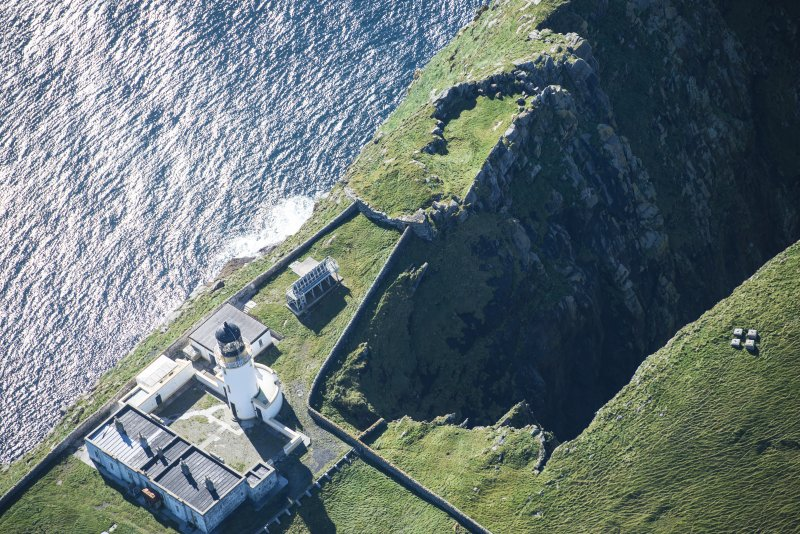 Oblique aerial view of Barra Head Lighthouse and the possible dun, looking WSW.
