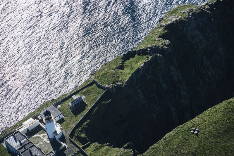 Oblique aerial view of Barra Head Lighthouse and the possible dun, looking SW.