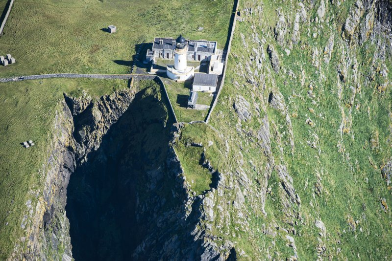 Oblique aerial view of Barra Head Lighthouse and the possible dun, looking E.