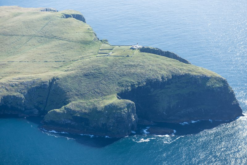 Oblique aerial view of Dun Briste and Barra Head Lighthouse, looking S.