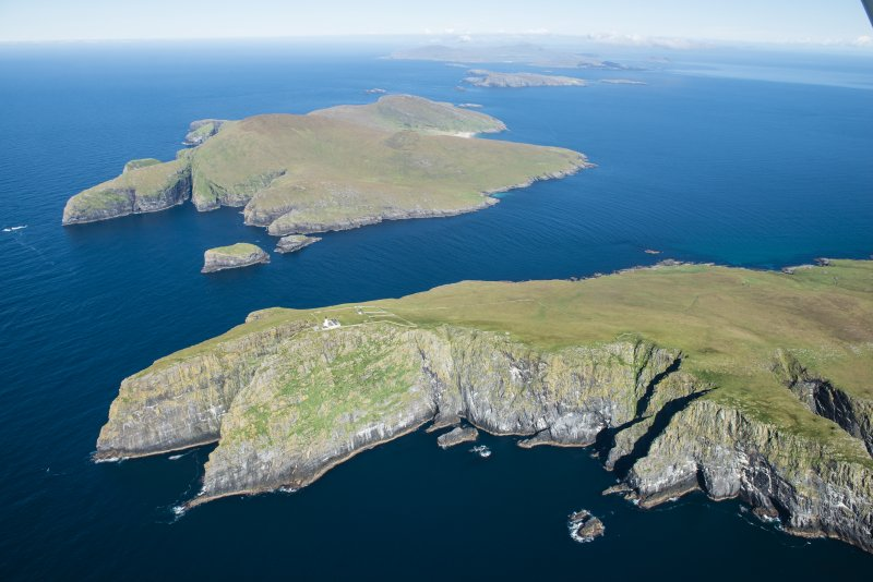 General oblique aerial view of Berneray and Mingulay with Barra Head in the foreground, looking NNE.