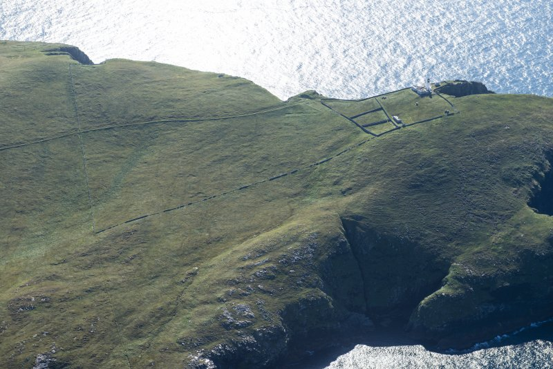 Oblique aerial view of Barra Head Lighthouse, looking S.