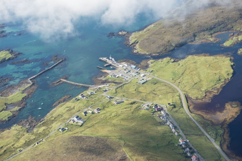 Oblique aerial view of Leverburgh and pier, looking W.
