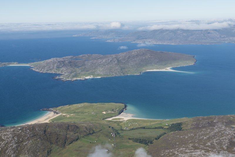 General oblique aerial view of Taransay with Luskentyre in the foreground, looking NW.