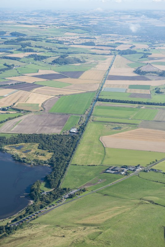 General oblique aerial view centred on the canalised section of the River Leven, looking NE.