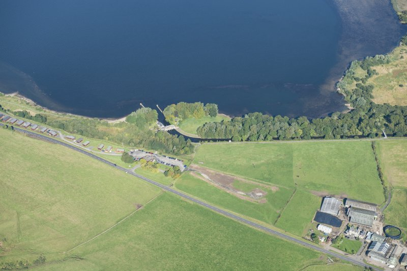 Oblique aerial view Loch Leven sluice and piers, looking NNW.