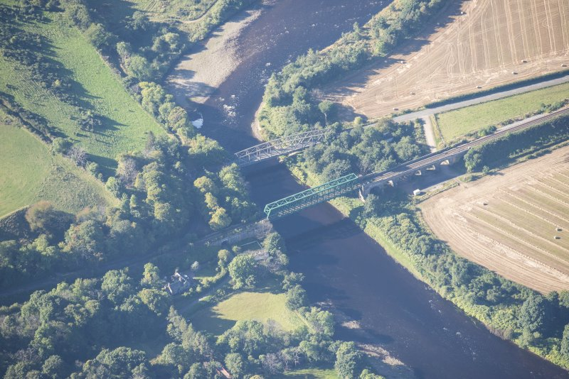 Oblique aerial view of Boat O' Brig New Bridge and Railway Bridge, looking SW.