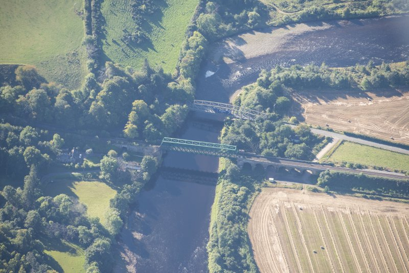 Oblique aerial view of Boat O' Brig New Bridge and Railway Bridge, looking SSW.